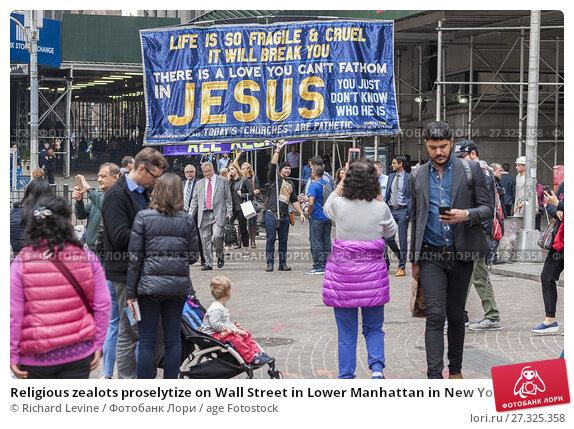 Купить «Religious zealots proselytize on Wall Street in Lower Manhattan in New York on Thursday, November 2, 2017.», фото № 27325358, снято 2 ноября 2017 г. (c) age Fotostock / Фотобанк Лори
