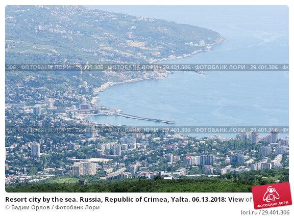 Купить «Resort city by the sea. Russia, Republic of Crimea, Yalta. 06.13.2018: View of Yalta and the Black Sea from Mount Ai-Petri», фото № 29401306, снято 13 июня 2018 г. (c) Вадим Орлов / Фотобанк Лори