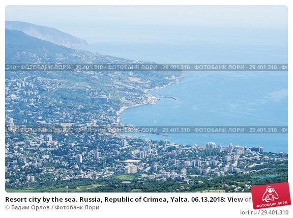 Купить «Resort city by the sea. Russia, Republic of Crimea, Yalta. 06.13.2018: View of Yalta and the Black Sea from Mount Ai-Petri», фото № 29401310, снято 13 июня 2018 г. (c) Вадим Орлов / Фотобанк Лори