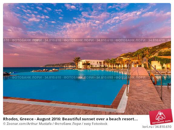 Rhodos, Greece - August 2016: Beautiful sunset over a beach resort... Стоковое фото, фотограф Zoonar.com/Arthur Mustafa / easy Fotostock / Фотобанк Лори