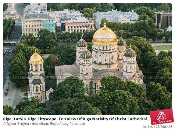 Купить «Riga, Latvia. Riga Cityscape. Top View Of Riga Nativity Of Christ Cathedral - Famous Church And Landmark In Summer Evening. Golden Yellow Domes.», фото № 28700466, снято 2 июля 2016 г. (c) easy Fotostock / Фотобанк Лори
