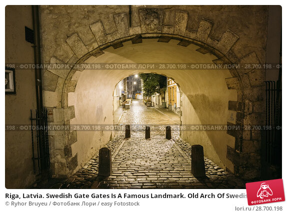 Купить «Riga, Latvia. Swedish Gate Gates Is A Famous Landmark. Old Arch Of Swedish Gate In Original State On Troksnu Street In Old Town. Cultural Monument In Lighting At Night Illumination.», фото № 28700198, снято 3 июля 2016 г. (c) easy Fotostock / Фотобанк Лори