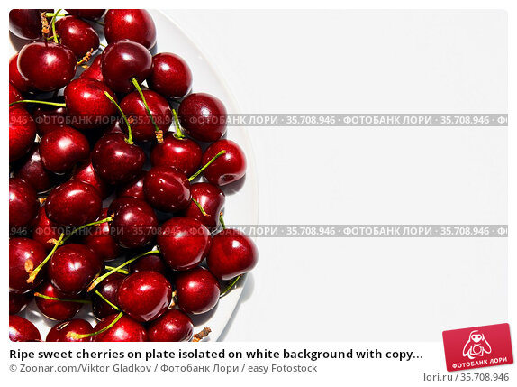 Ripe sweet cherries on plate isolated on white background with copy... Стоковое фото, фотограф Zoonar.com/Viktor Gladkov / easy Fotostock / Фотобанк Лори