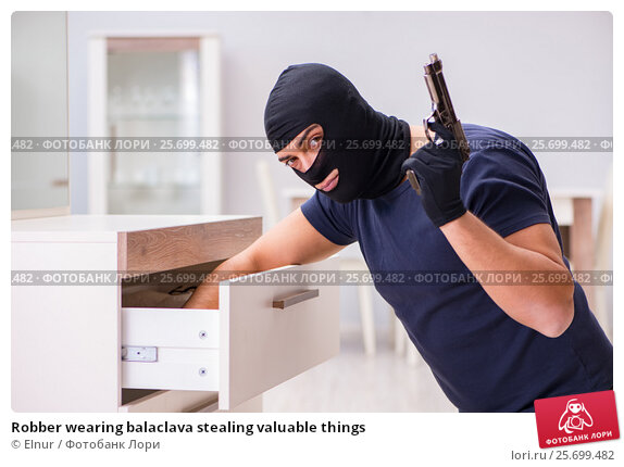 Robber wearing balaclava stealing valuable things, фото № 25699482, снято 12 декабря 2016 г. (c) Elnur / Фотобанк Лори