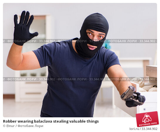Купить «Robber wearing balaclava stealing valuable things», фото № 33344902, снято 12 декабря 2016 г. (c) Elnur / Фотобанк Лори