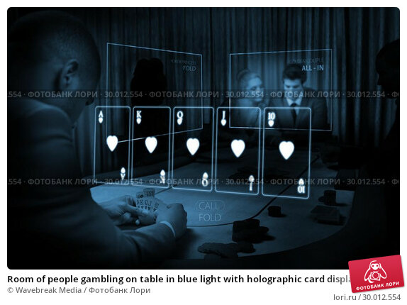 Купить «Room of people gambling on table in blue light with holographic card display», фото № 30012554, снято 19 августа 2013 г. (c) Wavebreak Media / Фотобанк Лори