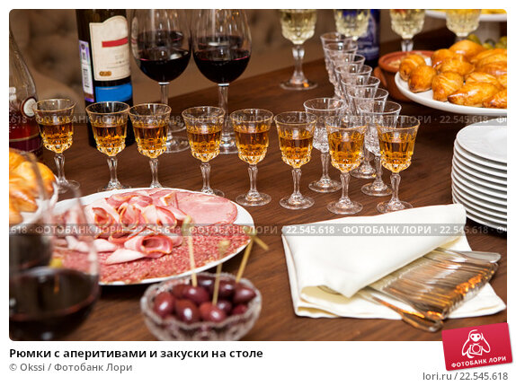 Купить «Рюмки с аперитивами и закуски на столе», фото № 22545618, снято 2 апреля 2016 г. (c) Okssi / Фотобанк Лори
