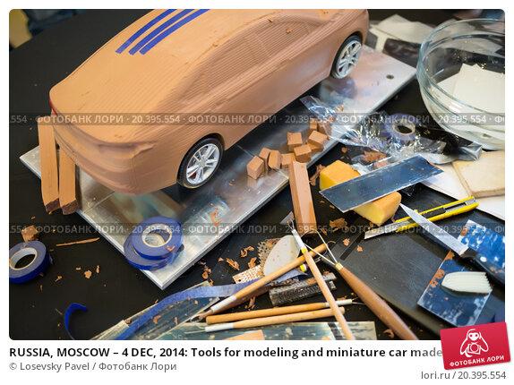 Купить «RUSSIA, MOSCOW – 4 DEC, 2014: Tools for modeling and miniature car made of clay at the press event for Ford in SREDA loft.», фото № 20395554, снято 4 декабря 2014 г. (c) Losevsky Pavel / Фотобанк Лори