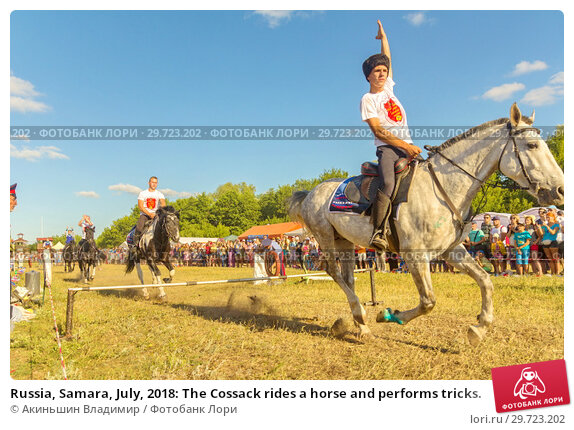 Купить «Russia, Samara, July, 2018: The Cossack rides a horse and performs tricks.», фото № 29723202, снято 29 июля 2018 г. (c) Акиньшин Владимир / Фотобанк Лори