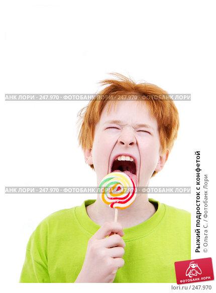 Рыжий подросток с конфетой, фото № 247970, снято 28 февраля 2008 г. (c) Ольга С. / Фотобанк Лори