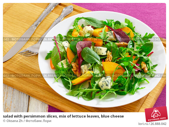 salad with persimmon slices, mix of lettuce leaves, blue cheese. Стоковое фото, фотограф Oksana Zh / Фотобанк Лори