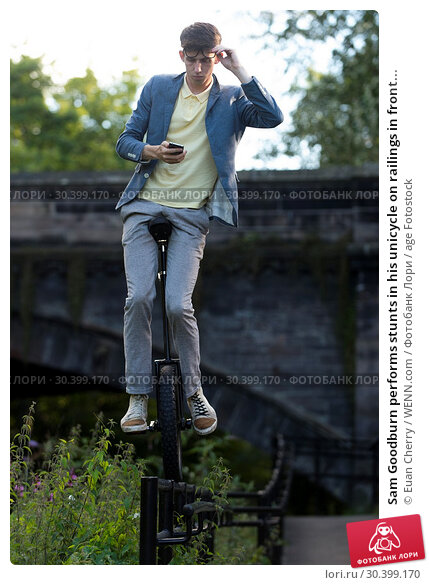 Купить «Sam Goodburn performs stunts in his unicycle on railings in front of StockBridge in Edinburgh. Featuring: Sam Goodburn Where: Edinburgh, United Kingdom When: 07 Aug 2017 Credit: Euan Cherry/WENN.com», фото № 30399170, снято 7 августа 2017 г. (c) age Fotostock / Фотобанк Лори