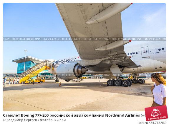 Самолет Boeing 777-200 российской авиакомпании Nordwind Airlines («Северный ветер») у нового международного терминала аэропорта Камрань (Cam Ranh International Airport). Вьетнам, провинция Кханьхоа (2018 год). Редакционное фото, фотограф Владимир Сергеев / Фотобанк Лори