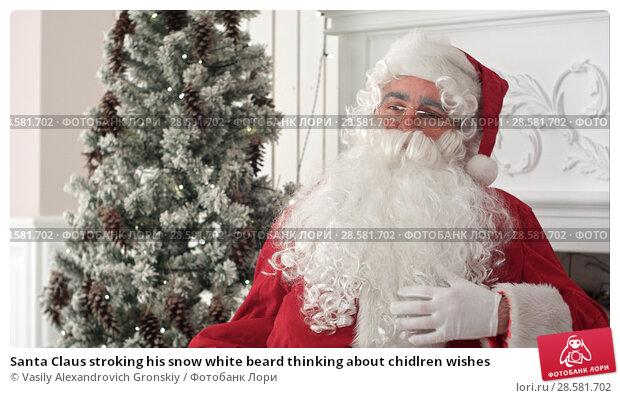 Купить «Santa Claus stroking his snow white beard thinking about chidlren wishes», фото № 28581702, снято 21 июня 2018 г. (c) Vasily Alexandrovich Gronskiy / Фотобанк Лори