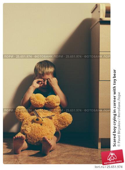 Купить «Scared boy crying in corner with toy bear», фото № 25651974, снято 23 мая 2019 г. (c) Pavel Biryukov / Фотобанк Лори