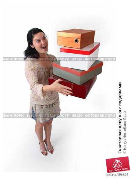 Счастливая девушка с подарками, фото № 89626, снято 21 июня 2007 г. (c) Harry / Фотобанк Лори