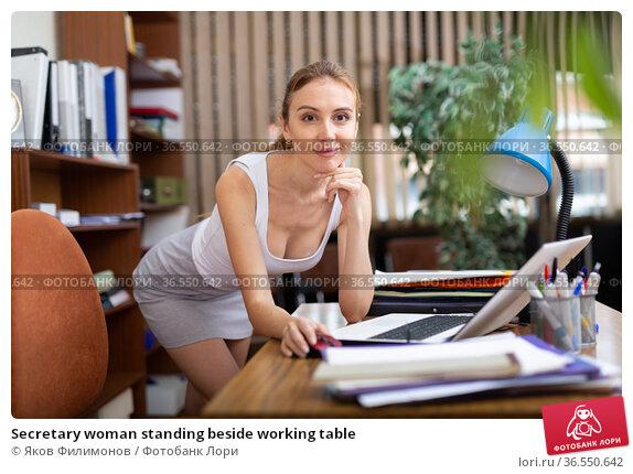 Secretary woman standing beside working table. Стоковое фото, фотограф Яков Филимонов / Фотобанк Лори