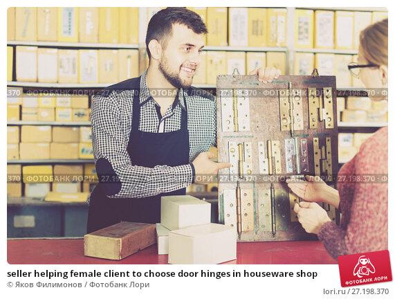 Купить «seller helping female client to choose door hinges in houseware shop», фото № 27198370, снято 5 апреля 2017 г. (c) Яков Филимонов / Фотобанк Лори