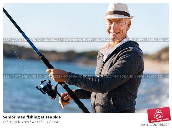 Купить «Senior man fishing at sea side», фото № 26036222, снято 15 апреля 2015 г. (c) Sergey Nivens / Фотобанк Лори