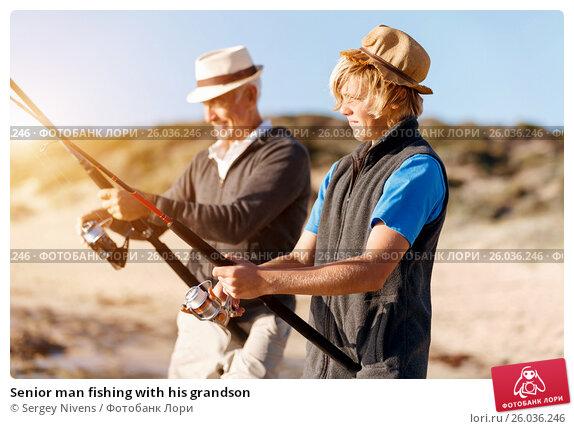 Senior man fishing with his grandson, фото № 26036246, снято 15 апреля 2015 г. (c) Sergey Nivens / Фотобанк Лори