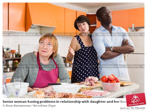Senior woman having problems in relationship with daughter and her husband. Стоковое фото, фотограф Яков Филимонов / Фотобанк Лори