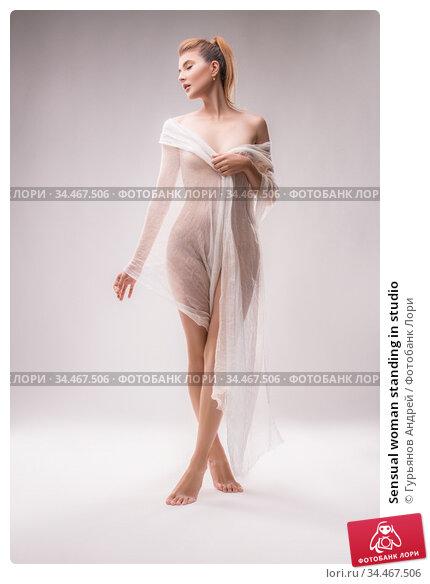 Sensual woman standing in studio. Стоковое фото, фотограф Гурьянов Андрей / Фотобанк Лори