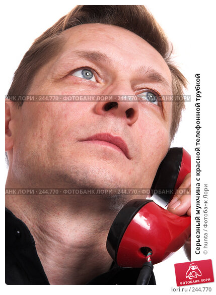 Купить «Серьезный мужчина с красной телефонной трубкой», фото № 244770, снято 18 октября 2007 г. (c) hunta / Фотобанк Лори