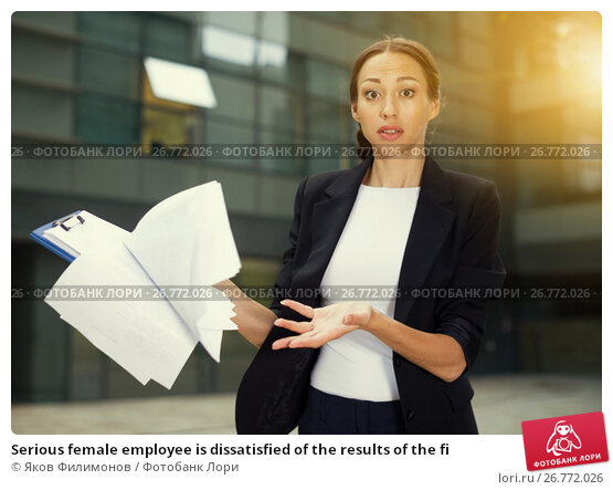 Serious female employee is dissatisfied of the results of the fi, фото № 26772026, снято 26 июня 2017 г. (c) Яков Филимонов / Фотобанк Лори