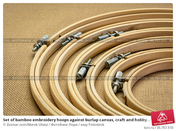 Set of bamboo embroidery hoops against burlap canvas, craft and hobby... Стоковое фото, фотограф Zoonar.com/Marek Uliasz / easy Fotostock / Фотобанк Лори