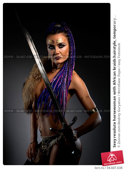 Sexy resolute horsewoman with African braids hairstyle, temporary... Стоковое фото, фотограф Zoonar.com/Andrey Guryanov / easy Fotostock / Фотобанк Лори