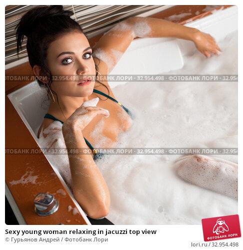 Sexy young woman relaxing in jacuzzi top view. Стоковое фото, фотограф Гурьянов Андрей / Фотобанк Лори