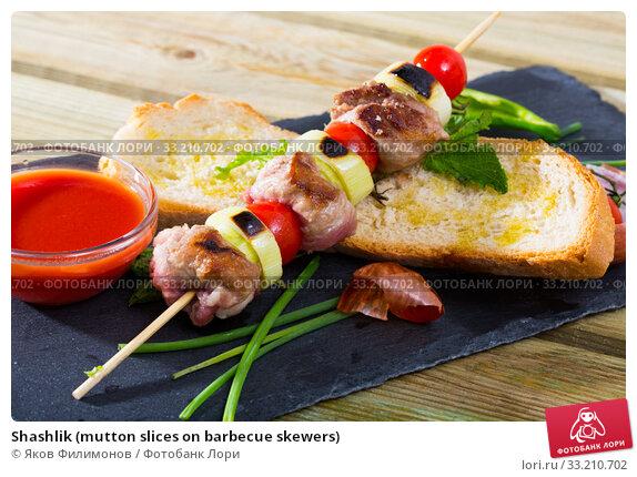 Купить «Shashlik (mutton slices on barbecue skewers)», фото № 33210702, снято 8 июля 2020 г. (c) Яков Филимонов / Фотобанк Лори