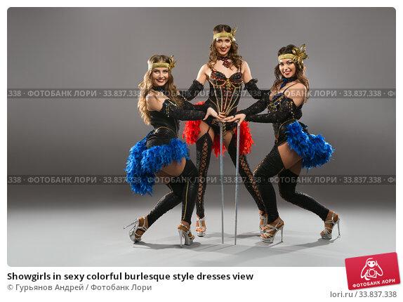 Купить «Showgirls in sexy colorful burlesque style dresses view», фото № 33837338, снято 12 апреля 2020 г. (c) Гурьянов Андрей / Фотобанк Лори