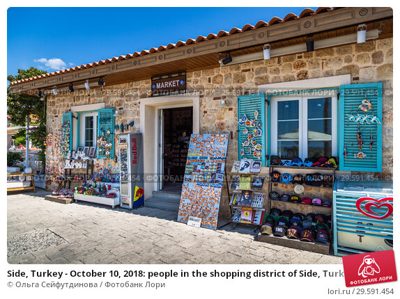 Купить «Side, Turkey - October 10, 2018: people in the shopping district of Side, Turkey.», фото № 29591454, снято 10 октября 2018 г. (c) Ольга Сейфутдинова / Фотобанк Лори