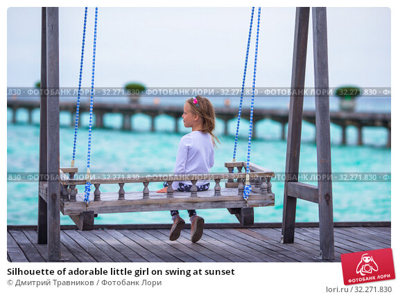 Купить «Silhouette of adorable little girl on swing at sunset», фото № 32271830, снято 7 апреля 2015 г. (c) Дмитрий Травников / Фотобанк Лори