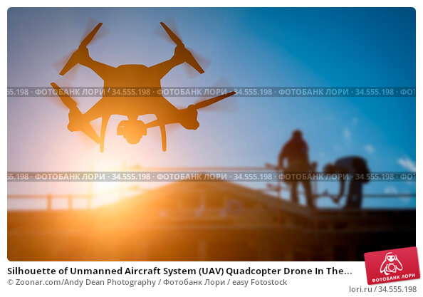 Silhouette of Unmanned Aircraft System (UAV) Quadcopter Drone In The... Стоковое фото, фотограф Zoonar.com/Andy Dean Photography / easy Fotostock / Фотобанк Лори