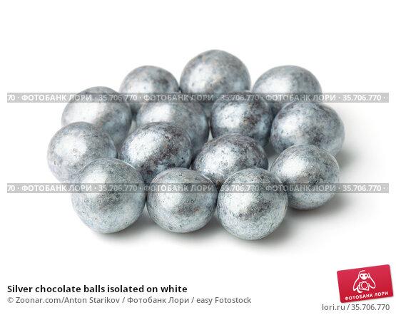 Silver chocolate balls isolated on white. Стоковое фото, фотограф Zoonar.com/Anton Starikov / easy Fotostock / Фотобанк Лори