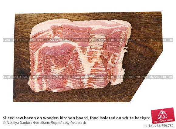 Sliced raw bacon on wooden kitchen board, food isolated on white background... Стоковое фото, фотограф Natalya Danko / easy Fotostock / Фотобанк Лори