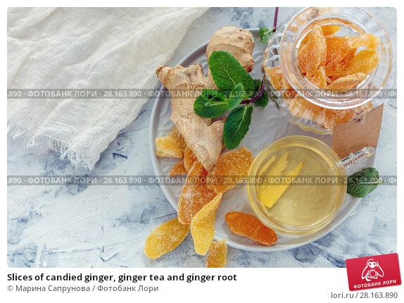 Купить «Slices of candied ginger, ginger tea and ginger root», фото № 28163890, снято 9 марта 2018 г. (c) Марина Сапрунова / Фотобанк Лори