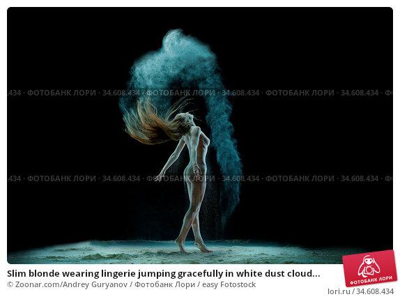 Slim blonde wearing lingerie jumping gracefully in white dust cloud... Стоковое фото, фотограф Zoonar.com/Andrey Guryanov / easy Fotostock / Фотобанк Лори