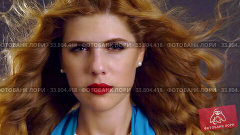 Купить «Slow motion of flying hair by hypnotic look beautiful woman», видеоролик № 33804418, снято 29 декабря 2019 г. (c) Gennadiy Poznyakov / Фотобанк Лори