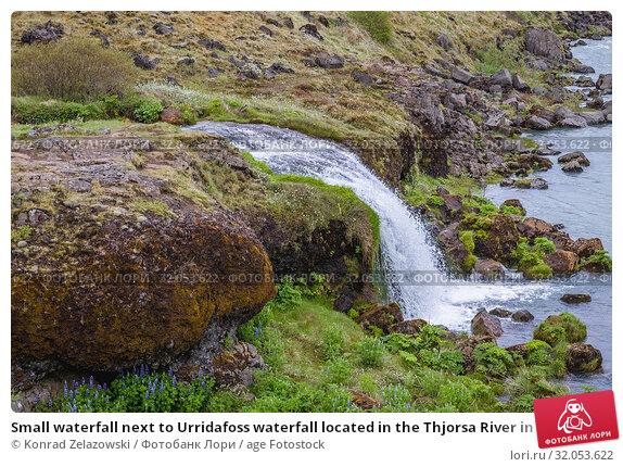 Small waterfall next to Urridafoss waterfall located in the Thjorsa River in southwest Iceland. Стоковое фото, фотограф Konrad Zelazowski / age Fotostock / Фотобанк Лори