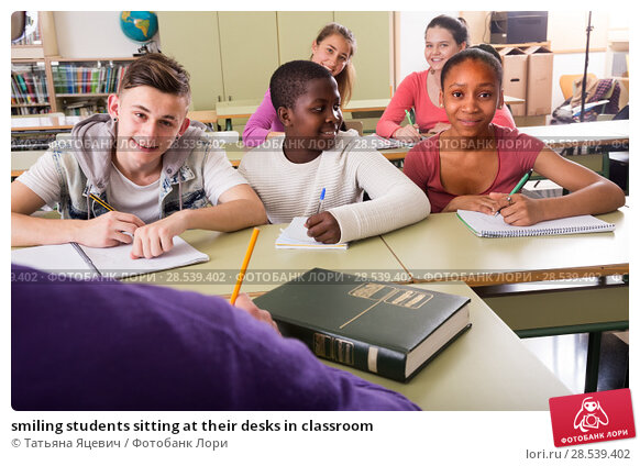 Купить «smiling students sitting at their desks in classroom», фото № 28539402, снято 16 января 2019 г. (c) Татьяна Яцевич / Фотобанк Лори