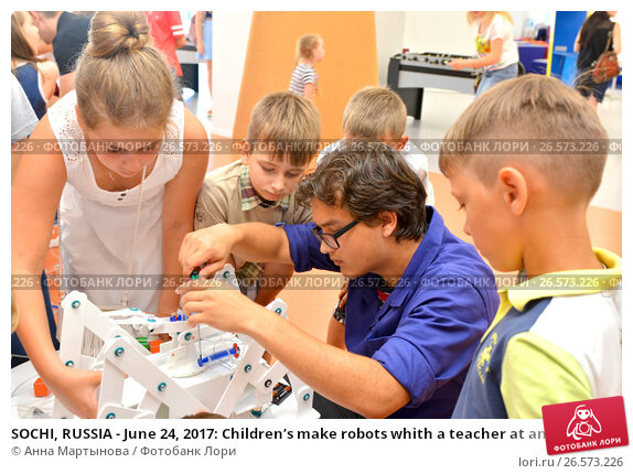 """SOCHI, RUSSIA - June 24, 2017: Children's make robots whith a teacher at an open lesson of the All-Russia Educational Center """"Sirius"""" in Sochi. Редакционное фото, фотограф Анна Мартынова / Фотобанк Лори"""