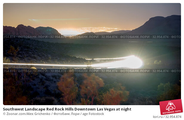 Southwest Landscape Red Rock Hills Downtown Las Vegas at night. Стоковое фото, фотограф Zoonar.com/Alex Grichenko / age Fotostock / Фотобанк Лори