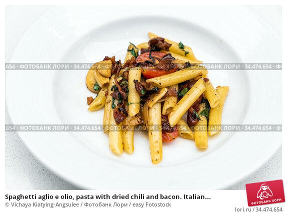 Spaghetti aglio e olio, pasta with dried chili and bacon. Italian... Стоковое фото, фотограф Vichaya Kiatying-Angsulee / easy Fotostock / Фотобанк Лори