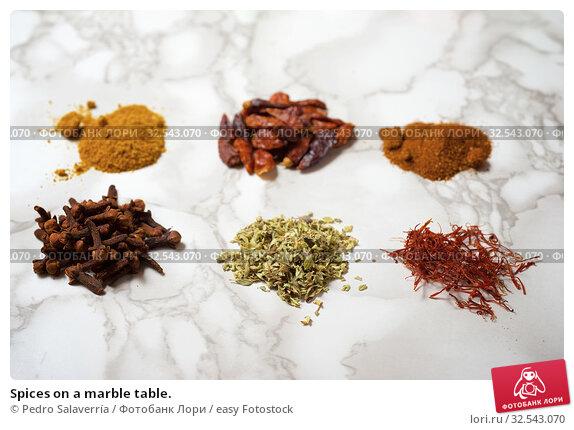 Купить «Spices on a marble table.», фото № 32543070, снято 26 сентября 2019 г. (c) easy Fotostock / Фотобанк Лори
