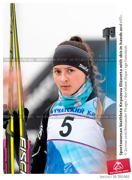 Sportswoman biathlete Knyazeva Elizaveta with skis in hands and rifle... Стоковое фото, фотограф Zoonar.com/Alexsander Piragis / age Fotostock / Фотобанк Лори