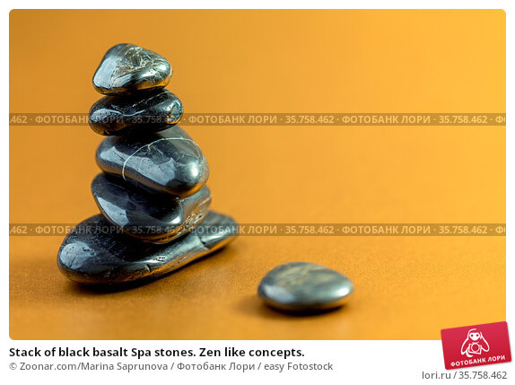 Stack of black basalt Spa stones. Zen like concepts. Стоковое фото, фотограф Zoonar.com/Marina Saprunova / easy Fotostock / Фотобанк Лори