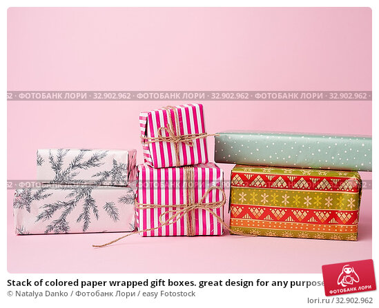 Stack of colored paper wrapped gift boxes. great design for any purposes. pink background. Стоковое фото, фотограф Natalya Danko / easy Fotostock / Фотобанк Лори